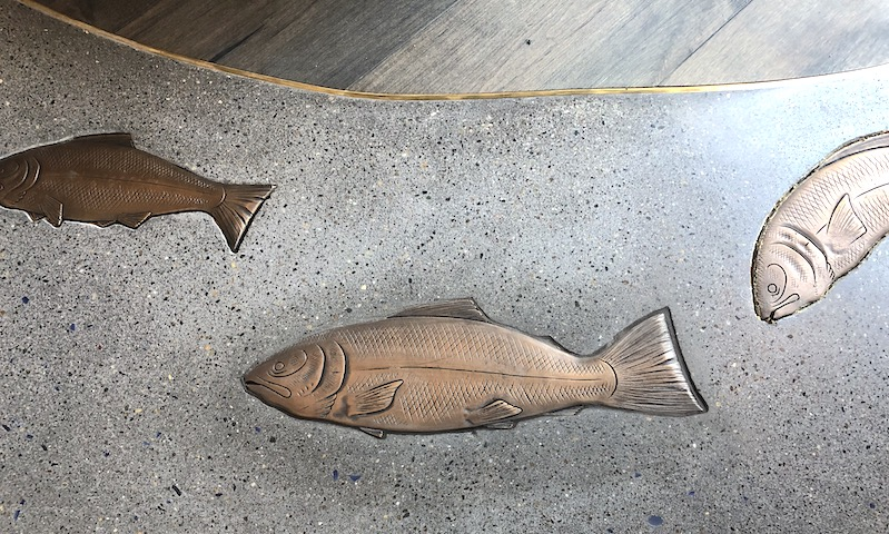 concrete art with bronze fish